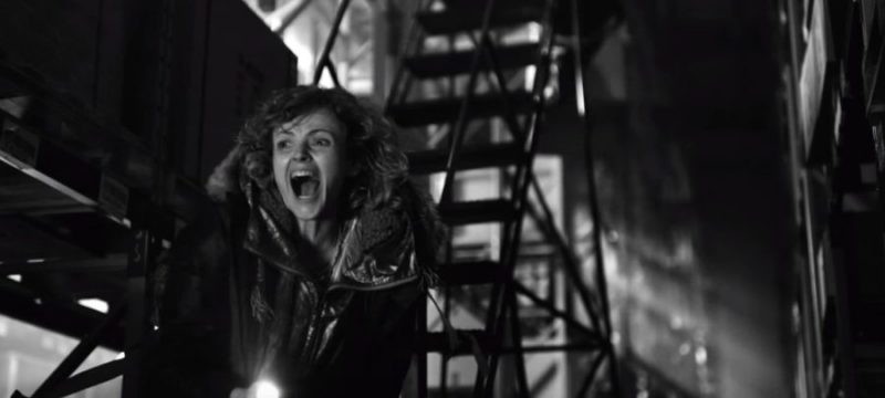 A black and white picture. Still from Black Mirror. A Woman screaming.