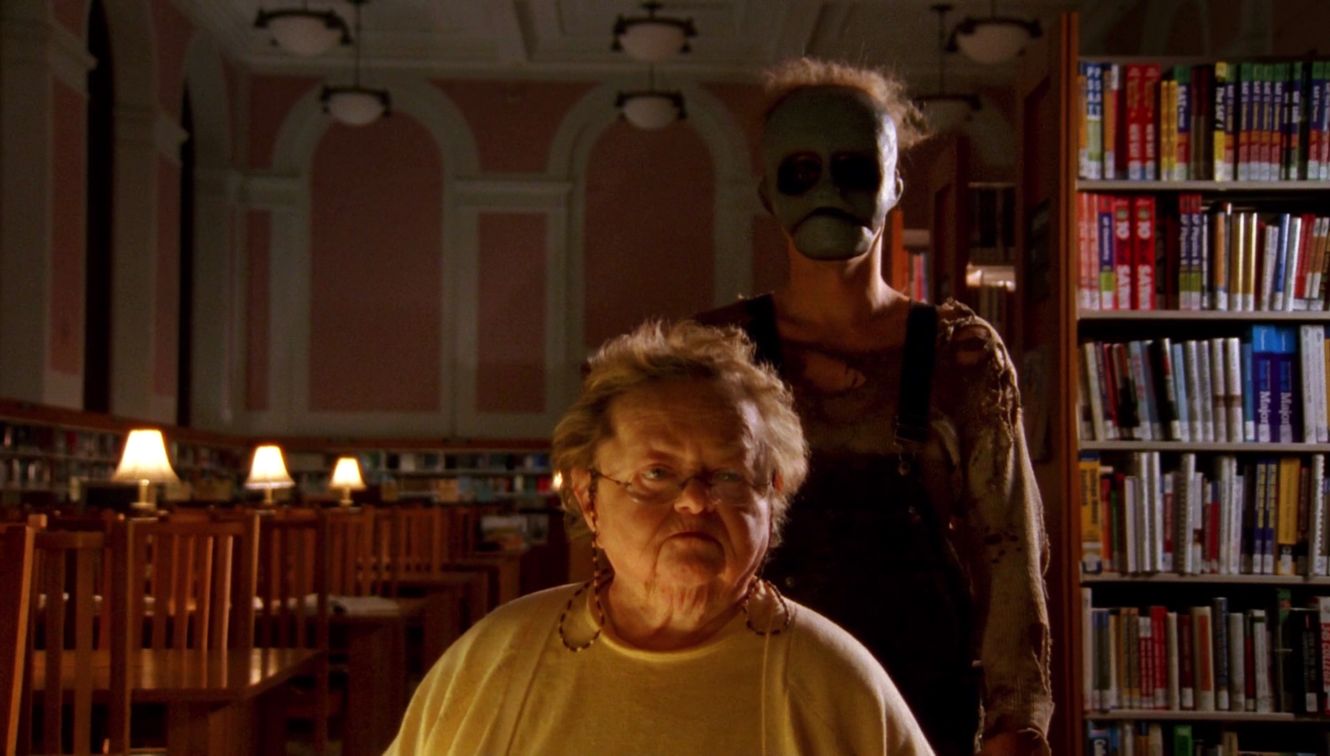 Behind the Mask: The Rise of Leslie Vernon's villain stands behind Zelda Rubinstein's character