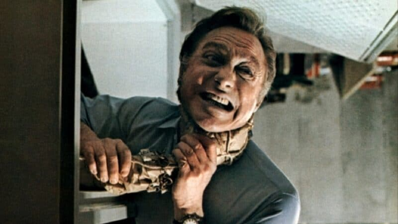 Walter is strangled by a disembodied arm in Asylum